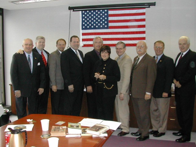 Pictured left to right in the attached photo are: John Buckman, John Sinclair, Marc Revere – Dennis Compton, Bill Pessemier, Janet Wilmoth, Randy Bruegman, Ronny Coleman, Gary Briese, Jim Broman.